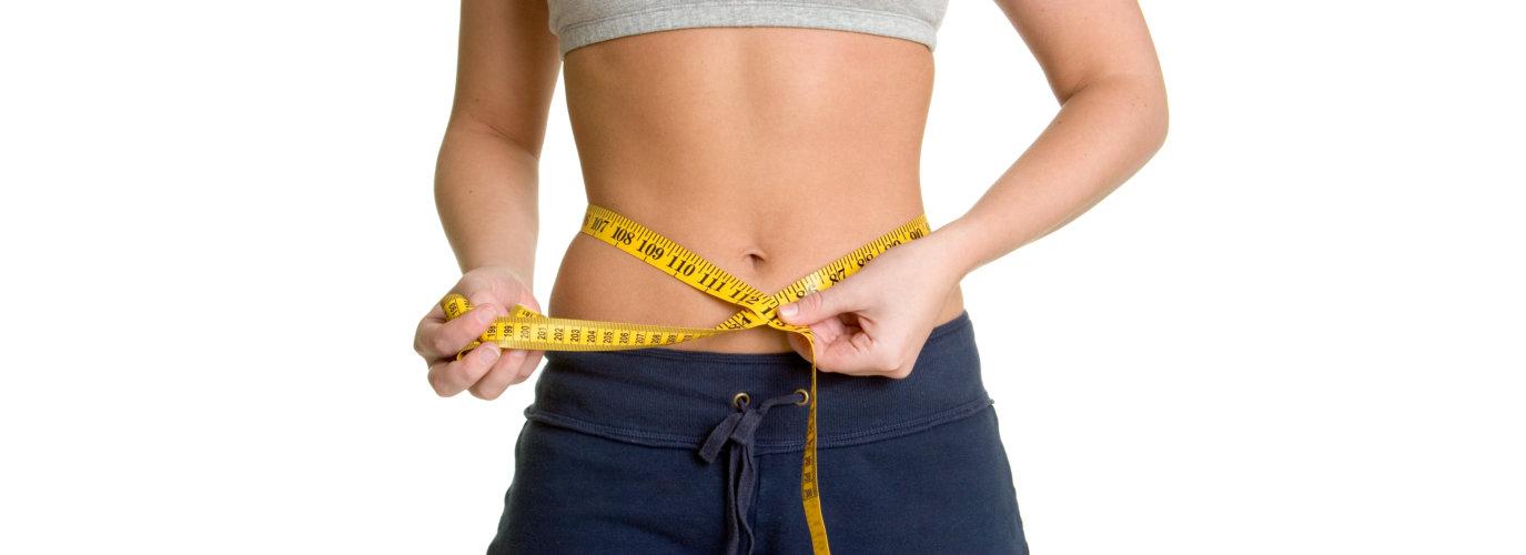 Weight loss woman measuring waist